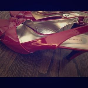 Red open toe pumps